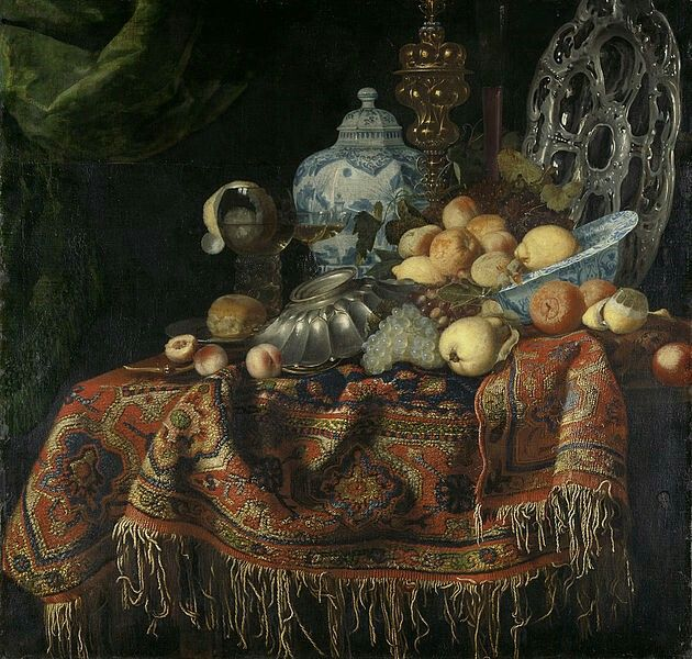 Francesco Fieravino (genaamd Il Maltese)TitleStilleven met vruchten en vaatwerk op een Smyrna kleedDescription  Nederlands:Stilleven met vruchten en vaatwerk op een Smyrna kleed. Op een tafel bedekt met een Oosters tapijt liggen een Wan Li-schaal met appels en citroenen, zilveren schalen, een gouden pronkbeker, een brood op een tinnen bord, een roemer met wijn waarin een geschilde citroen hangt, verder druiven en een peer. Achteraan staat een grote porseleinen vaas of pot.  Datebetween…