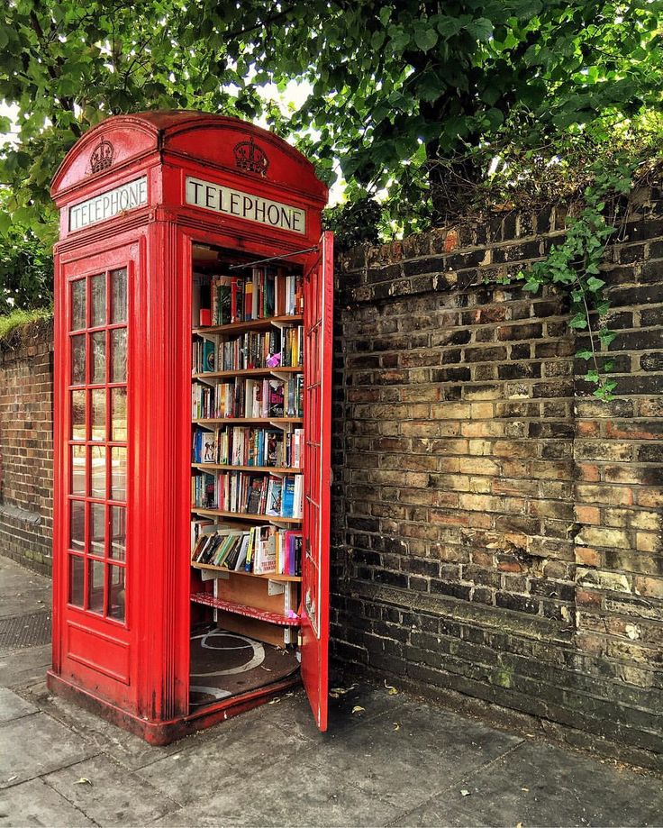 "photo by @london • A book borrowing phone box in Greenwich ""I have seen one of these in a tiny village in Yorkshire"""