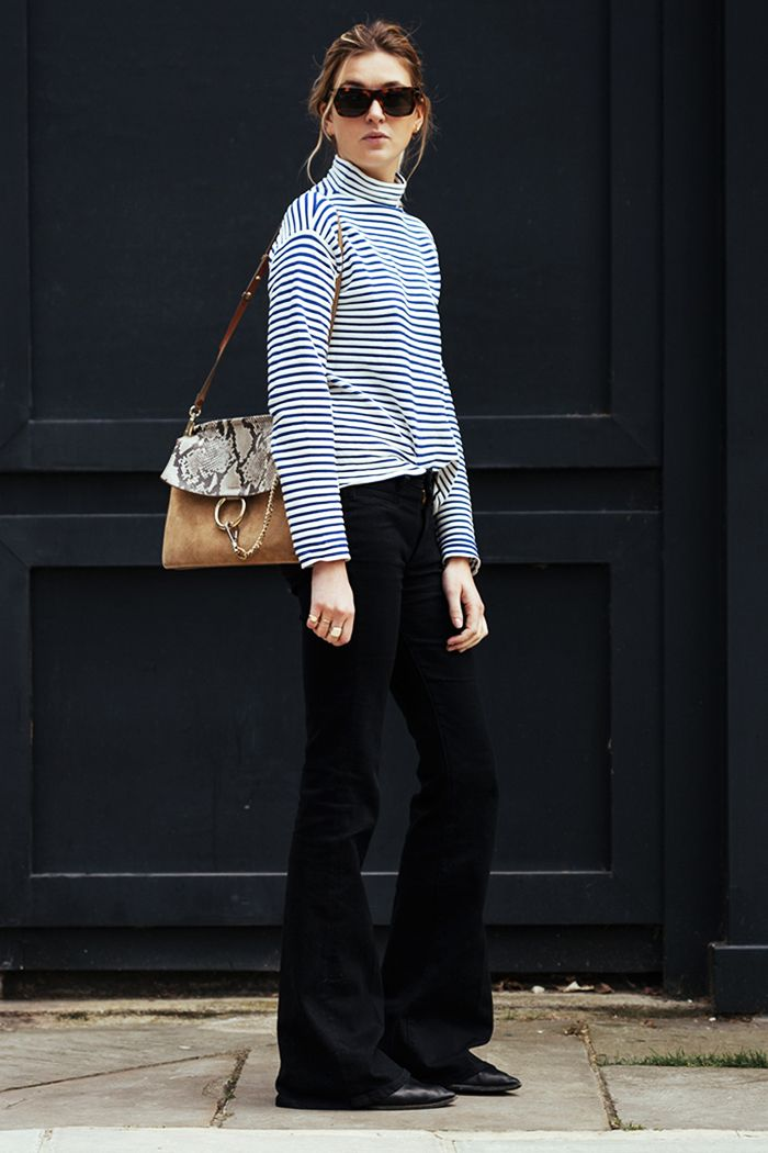 A striped turtleneck is paired with a Chloé bag, flared jeans, and flats