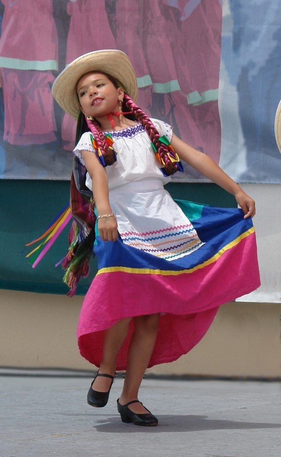 Happy Mexican girl dancing ... All children are beautiful but especially the Mexican children wearing traditional clothing.
