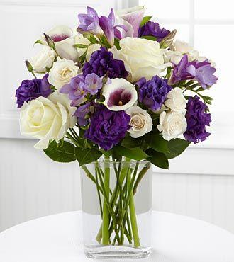Purple & White Picasso Calla Lilies, Purple Lisianthus, Lavender Freesia, White Roses, and Cream Spray Roses