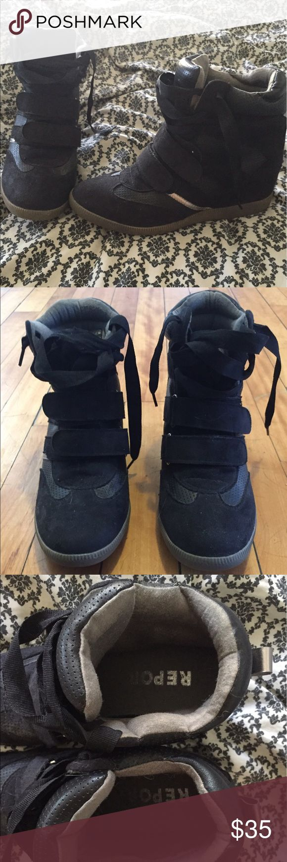 Black high top wedge heel sneakers Black high top sneakers with hidden wedge heel.  Lace and Velcro tie up detail.  Never worn out. Report Shoes