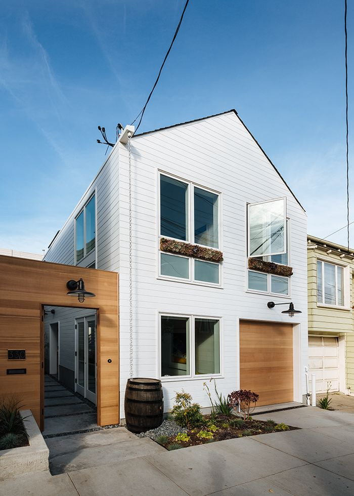San Francisco remodel with white exterior and large windows By Architect Karen Curtiss of Red Dot Studio.