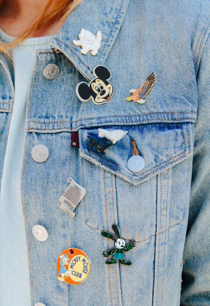 Disney pins on a jean jacket