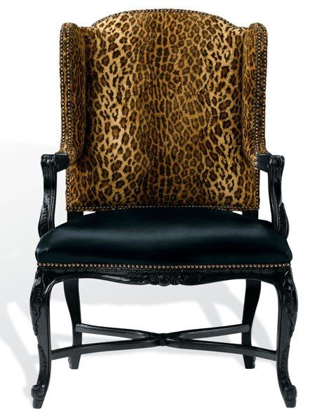 """Love that leopard!  Spencer chair with nailhead trim, with European-beech frame available in a variety of finishes (shown here in black lacquer) and a choice of fabric, leather, or c.o.m. upholstery (pictured here in Buckmaster Ebony leather on seat, Aragon Leopard fabric on seat back), 45.5"""" h. x 30"""" w. x 27"""" d., from $5,745."""