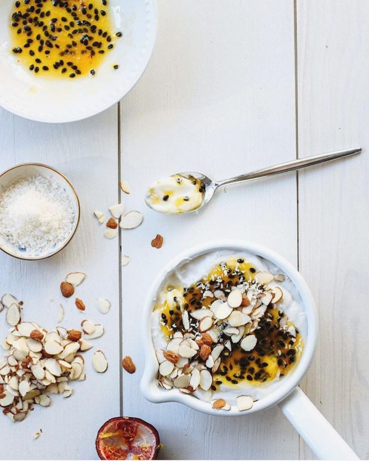 What does #cleaneating mean to us? Well it means insanely delicious homemade coconut yogurt and passion fruit like this one from @thebeelake 's Erin Asaad chocked full of nutrients served up in our pretty wares topped with sliced almonds. Glad you asked.  #paleoeats #dairyfree #guthealth #paleofood #healthyliving #powerbreakfast by kettleandbrine