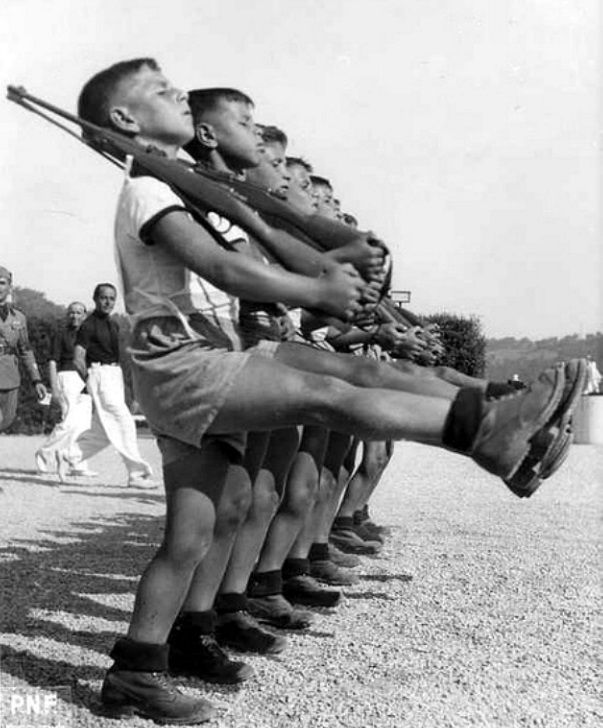 Members of the Gioventù Italiana del Littorio (GIL) (Italian Youth of the Lictor), the consolidated youth movement of the National Fascist Party of Italy, during a practice drill. 1939.