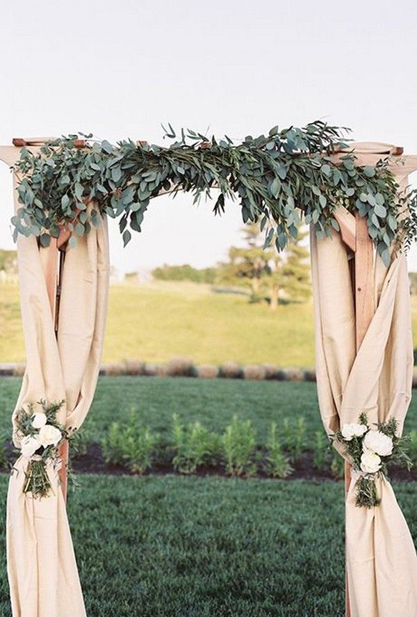 outdoor wedding arch ideas with garland and fabric #wedding #wedding #weddingarches #greenery #