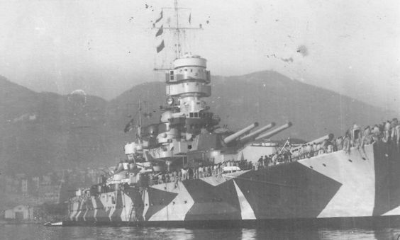 Italian battleship Roma in camouflage at anchor, date unknown...
