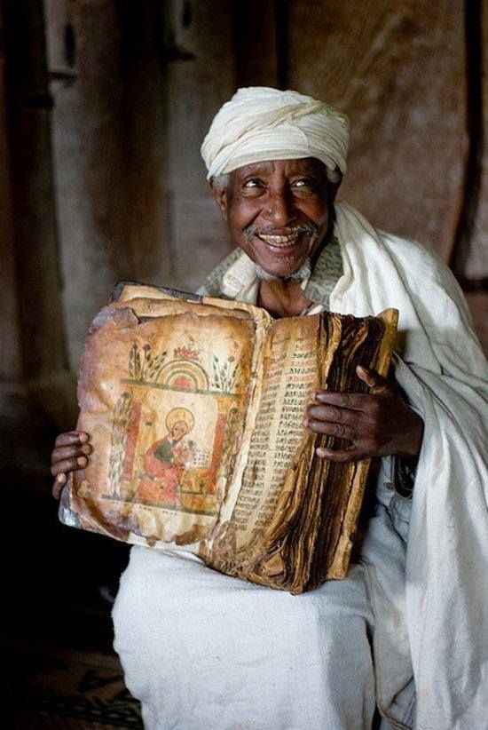 an Ethiopian priest with an 800 year old bible