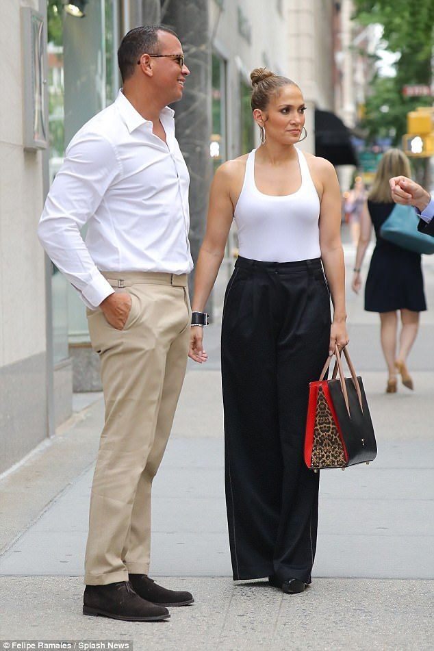 What a knockout:Her black tuxedo style pants were cinched at her petite waist as the tailored cut allowed her gorgeous gams to be on full display