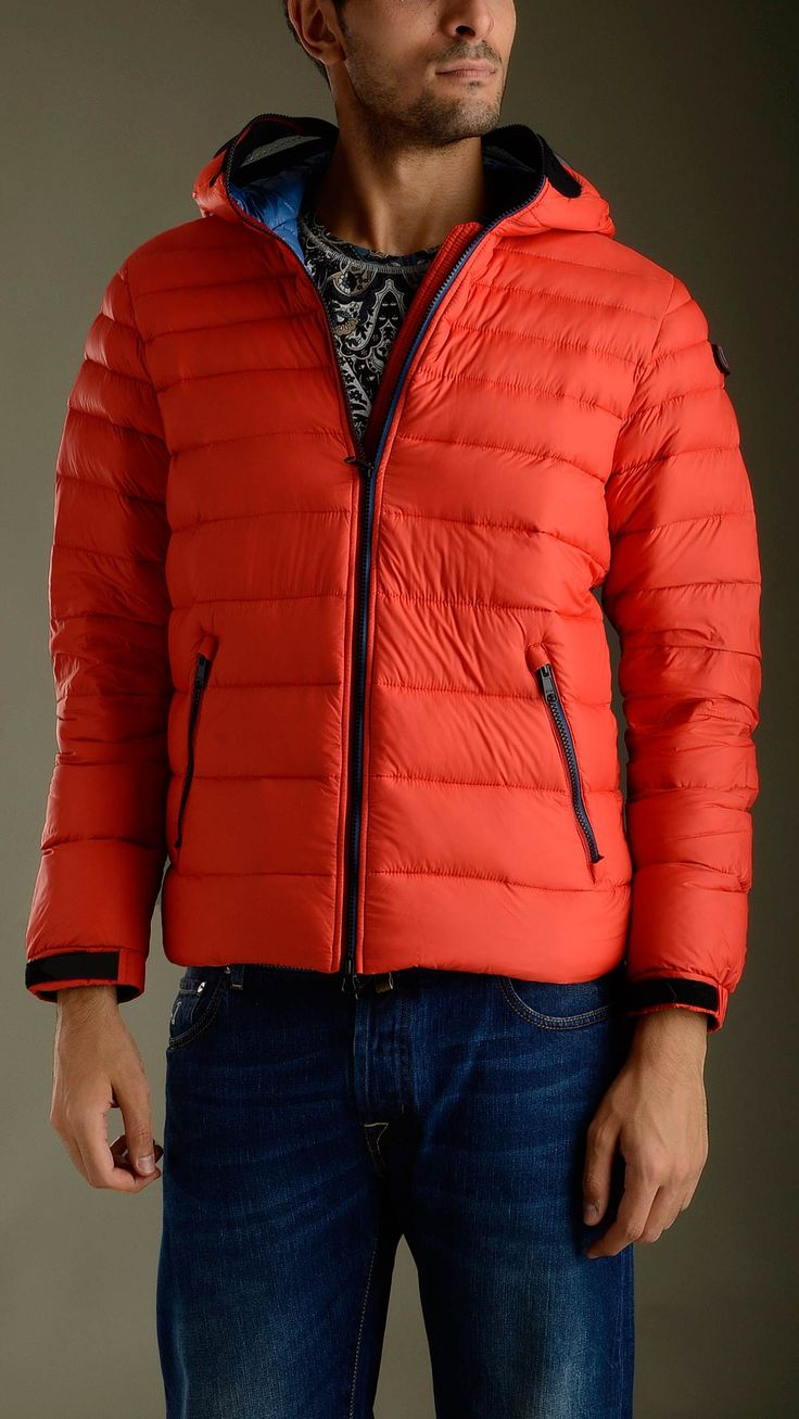 Ultra light down jacket in red featuring zip fastening with double puller, long sleeves, two zippered seam pockets, inner pockets, elasticized waistband, Velcro cuff closure, no detachable hood, removable polycarbonate lenses in silicone frame, mesh grate detailing ears and mouth, removable pompom, regular fit, 100% polyamide, padding 100% goose down feather.