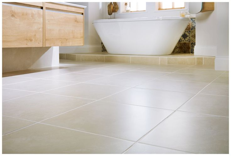 Large format floor tiles in natural crème are both smart and easy to care for #halo #modular #bathroomfurniture #tiles #myutopia
