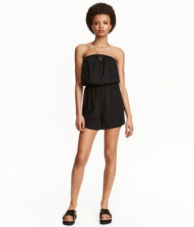 Strapless jumpsuit in woven fabric with elastication at top and at waist. Short legs.