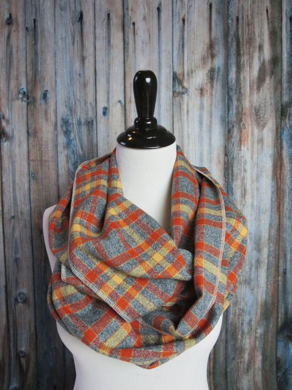 ♥ Orange, mustard, and gray flannel combine to make this a stunning plaid scarf.  ♥ Plaid flannel infinity scarf, extra-long and handmade in America from a soft, medium weight, yarn-dyed flannel. Scarf is a wide layer of comfortable cotton.  ♥ The medium weight flannel provides fullness and warmth.  ♥ All edges are serged. The seams are professionally finished with the Ooh Baby Signature Seam.  ♥♥♥ View More Plaid Flannel Scarves here → http://etsy.me/1tbHGWi ♥♥♥  ♥ Flannel is ...