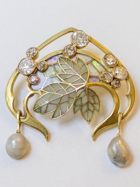 An Art Nouveau gold, diamond, opal, pearl, plique-à-jour enamel brooch by Georges Fouquet, circa 1900.