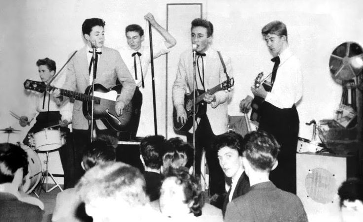 Paul McCartney and John Lennon. It was taken on November 23, 1957 in The New Clubmoor Hall on Broadway in Liverpool.