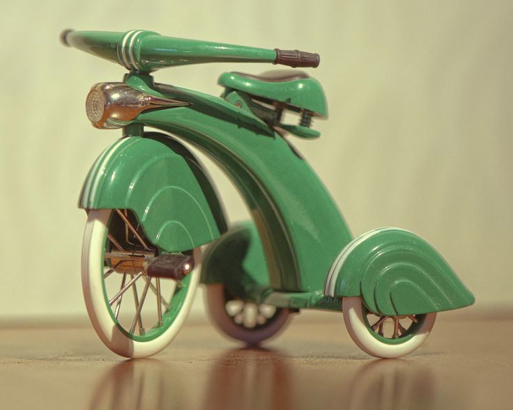Retro tricycle....what kid wouldn't look cool riding down the sidewalk on this sleek, green beauty of a bike.