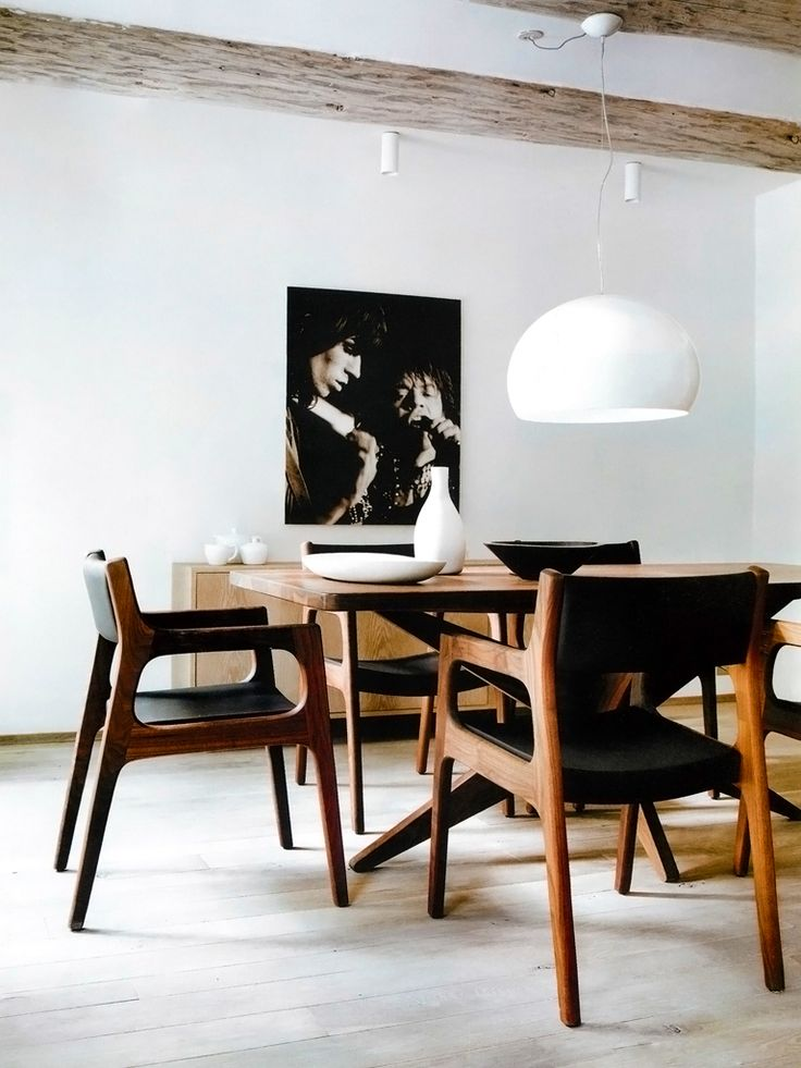 Black, white and wood dining room with modern pendant lamp. Love those chairs.