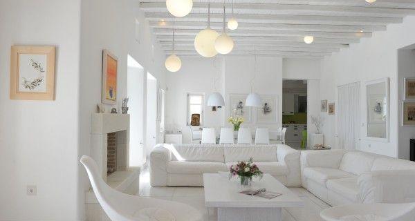 Living Room and Dining Table of Moonlight Villa in Paros Greece. http://instylevillas.net/property/moonlight-villa-paros/