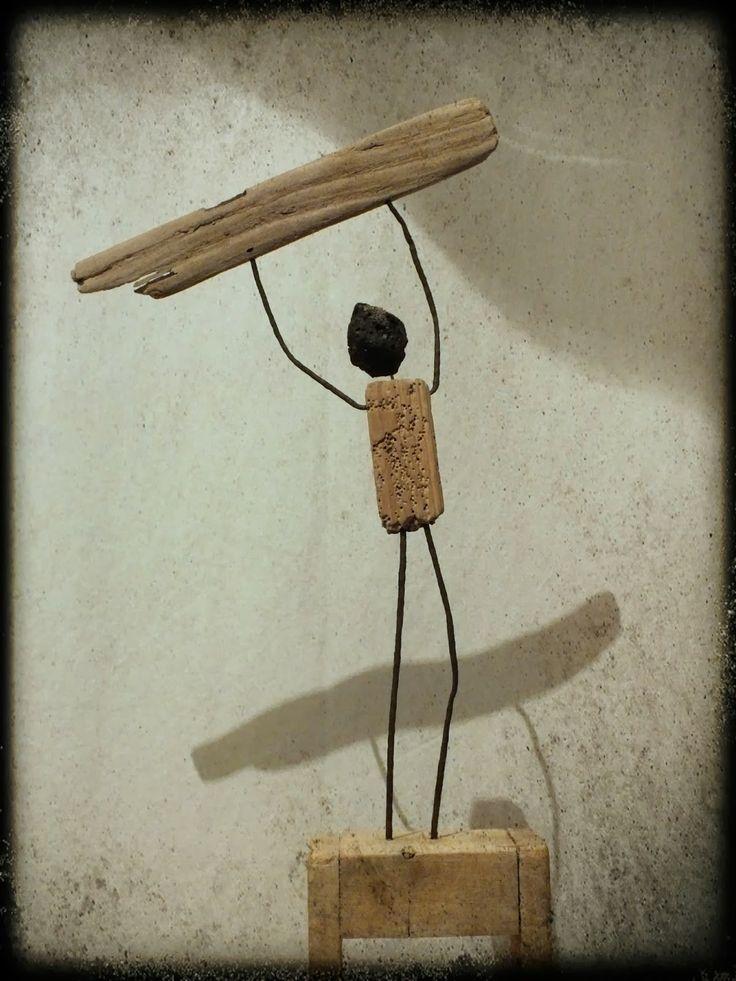 Mutoz inc. Art en bois flotté: World Champion ! Statue de surfeur en bois flotté et métal oxydé...