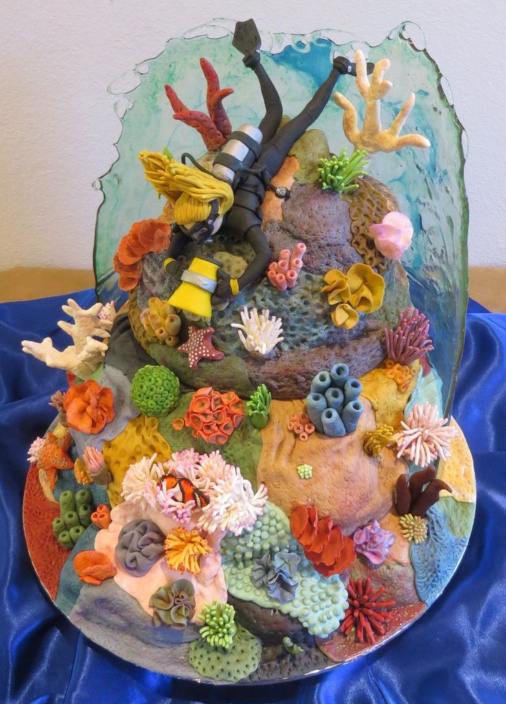 Scuba Diving Coral Reef Cake With Working Dive Light And Edible Glass Water Vanilla Buttercream cake covered in fondant live rock to make...