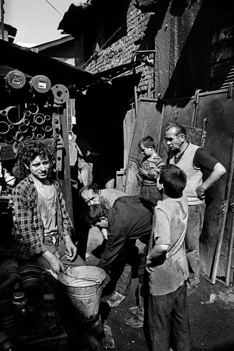 Ara Guler TURKEY. 1969. Young workers at the repairs wharf.