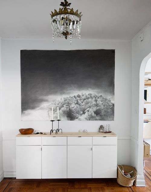 foyer, with a faux credenza on the wall made from Ikea kitchen cabinets hung low. graphite piece by kimi weart.