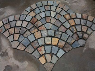 Kakadu Rustic Cobblestones on mesh sheets in a Fan Pattern Suited to Driveways, Pathways and patio areas. New Product and must be ordered in..