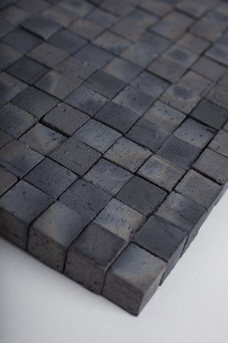 ceramic-like roofing material made from soil and carbon