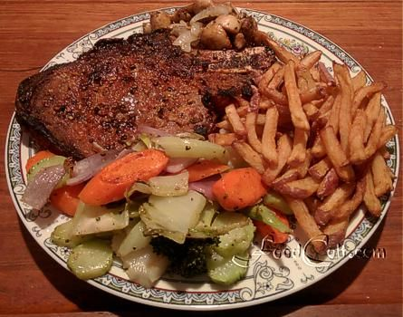 This #broiled steak was #seasoned with #OliveOil; fresh, finely grated garlic; a little salt, freshly cracked #pepper, and #smoked #paprika; and was served with #mushrooms #PanFried in yellow #onion and #garlic, mixed, steamed #vegatables (#carrot, #brocolli with stalk, #cauliflower leaf, and red #onion) finished in a hot #pan, and #frenchFries from one red #potato (skin on). Free, Easy #Recipes @ http://www.foodcult.com - #Food Matters!