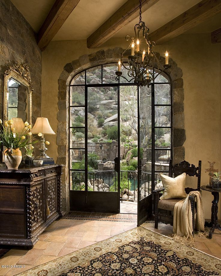 Glass doors leading out to terrace and spectacular view beyond.