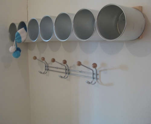 Formula cans turned hat/mitten storage. Use similar and do in closet on wall with unused space?