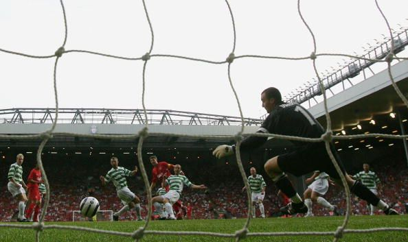 Steven Gerrard of Liverpool fires his shot past Gerard Doherty of TNS to score the first goal during the UEFA Champions League first qualifying round...