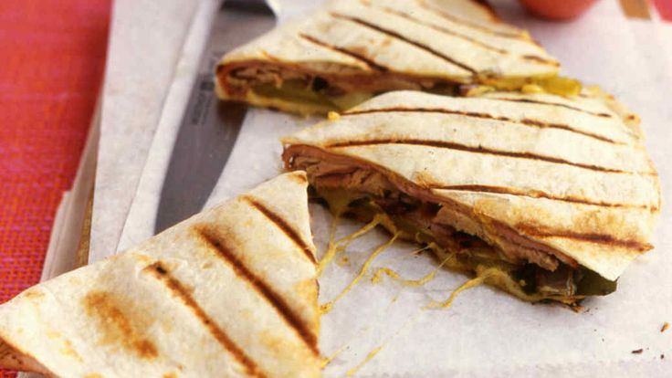 This version is inspired by the Cuban sandwich; bread is replaced with tortillas and grilling them adds a smoky flavor.