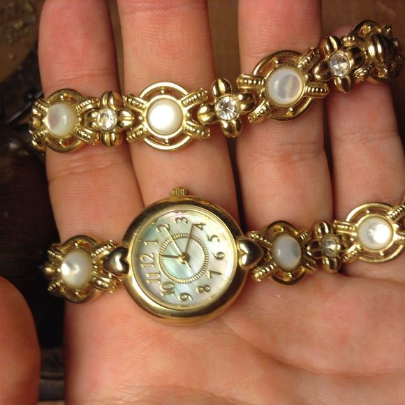 Beautiful Gold watch and matching bracelet Real Gold. Can add a free gift  by choice with purchase of this item; free with purchase gifts are listed in my closet. Accessories Watches