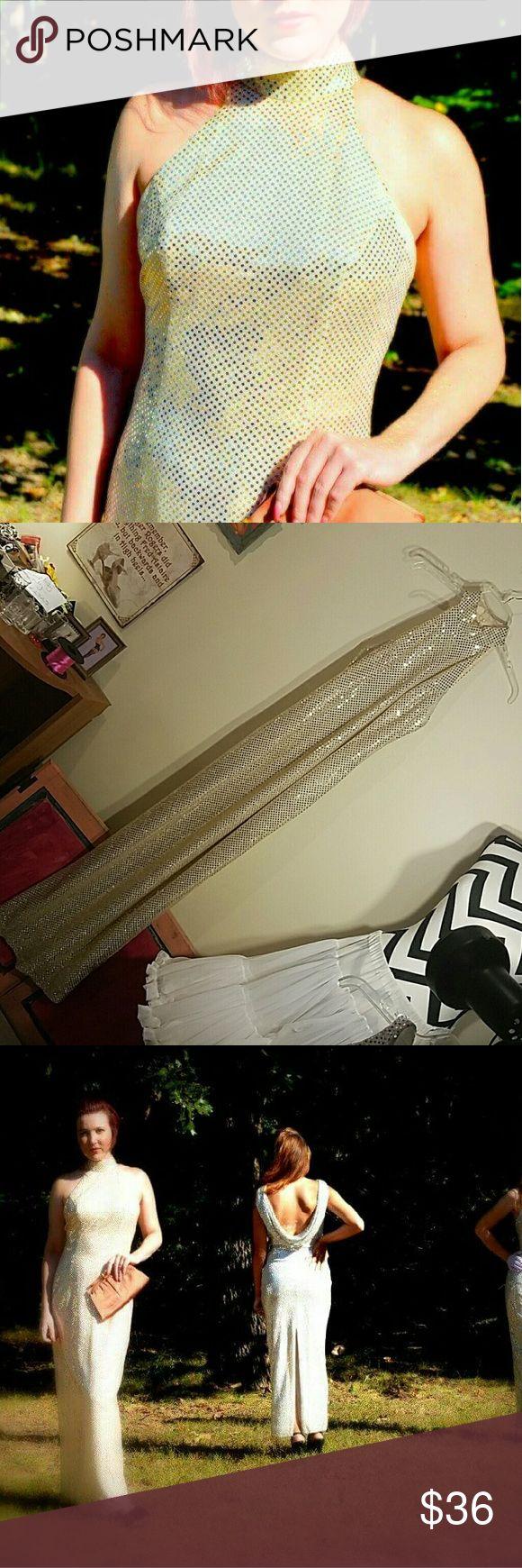 Stunning Sparkling Floor Length Flapper Dress Retro piece.   Size 7/8 Gold Low cut dip down back Choker bodice cut  Slit up the back Bust 32 Waist 28 Hips 34 Hand wash only. Roberta Dresses Maxi