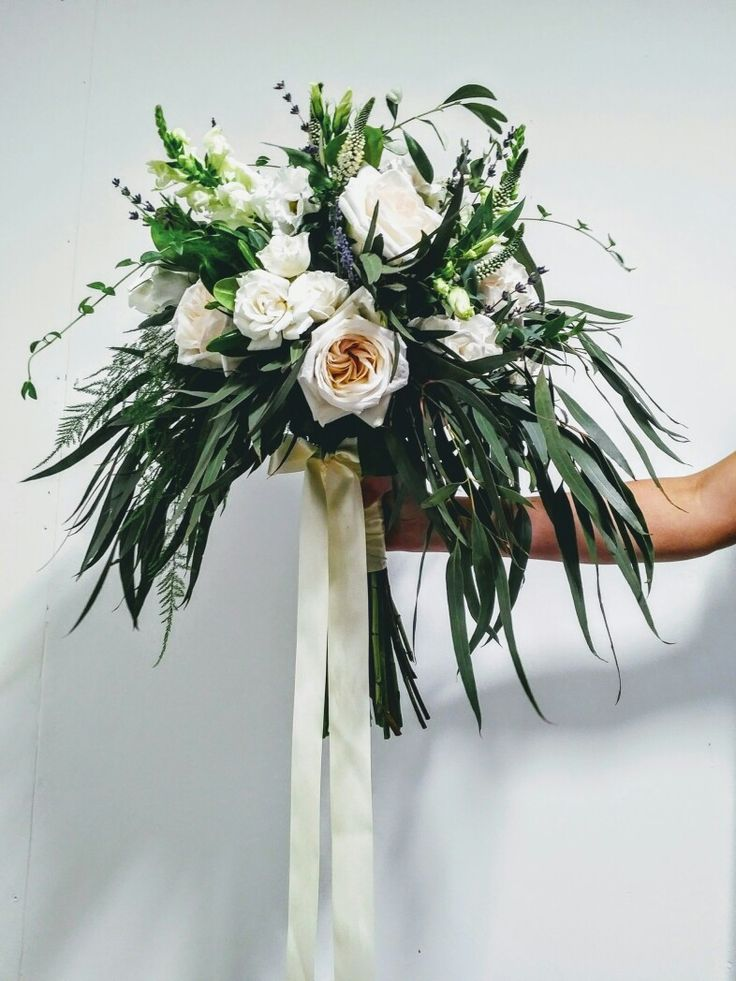 Stunning garden style bridal bouquet created by Peony House Floral Studio.  O'hara roses, snapdragons, lavender, willow eucalyptus, fern, eucalyptus parvifolia, white majolica spray roses, white veronica, olive branch...