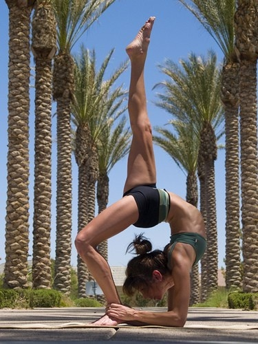 umm.. I wanna be able to strike this pose! (I usedta could back in the gymnast days.. lol)