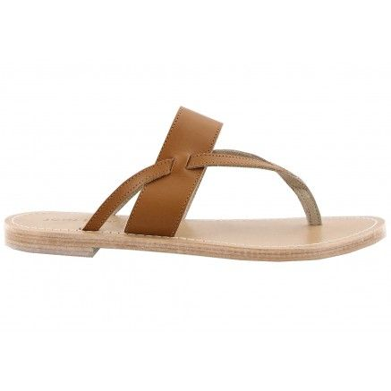A tan leather sandal with a thong opening.  Leather upper and leather lining.