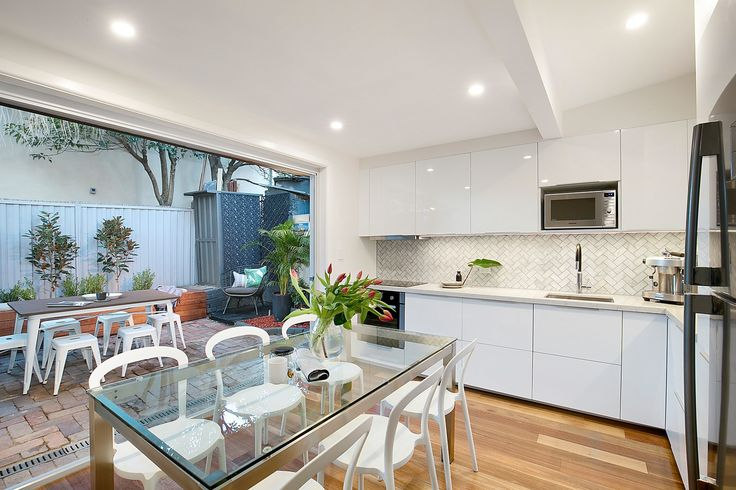 Kitchen with stone finish, brand appliances - 39 Marion Street Leichhardt at Pilcher Residential