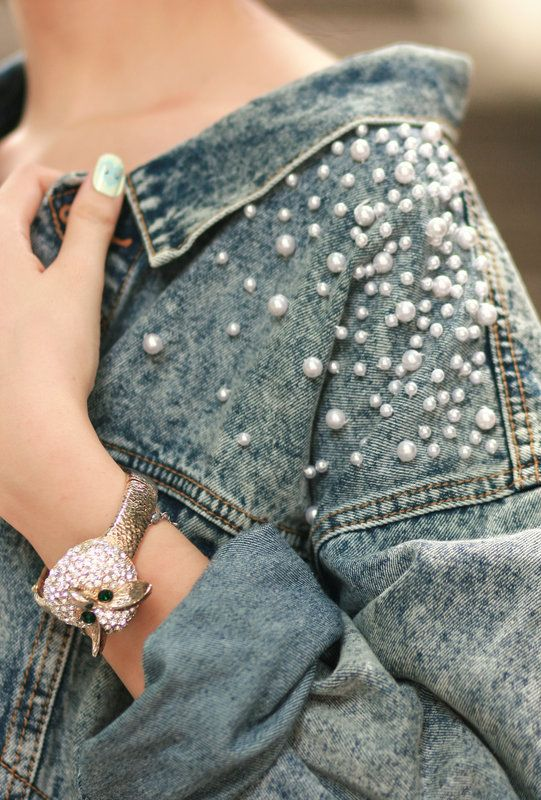 Pearl denim jacket. I like them on the top, back side by the shoulder blades. A.P.