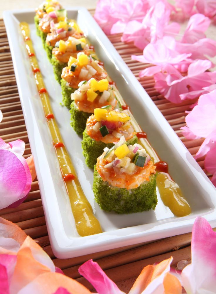 Tropical Roll - Cucumber, mango & avocado rolled & topped with spinach tempura bits, spicy shrimp mixed with masago & mango salsa (RA Sushi)