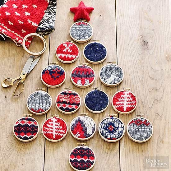Create cozy DIY tree decorations using affordable supplies you may already have stashed around the house. Simply place a small piece of a holiday sweater in a 3-inch embroidery hoop, tighten the hoop, and trim the swatch to fit accordingly. Hang these mini ornaments with strands of ribbon./