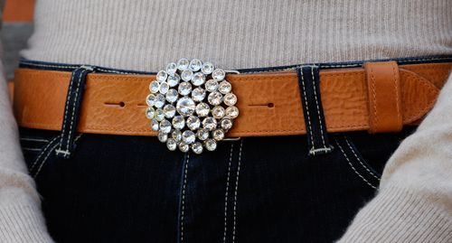 Detachable white waterlilly buckle in Swarovski crystal £75 on tan leather belt £75