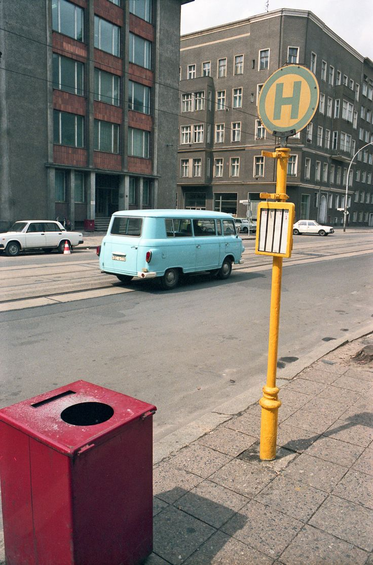 East Berlin: Bus stop on Orianenburger Strasse near the corner with Tucholskystrasse, in 1985. This is an old iron bus stop, hence the need for the thick coats of yellow paint to stop it rusting.