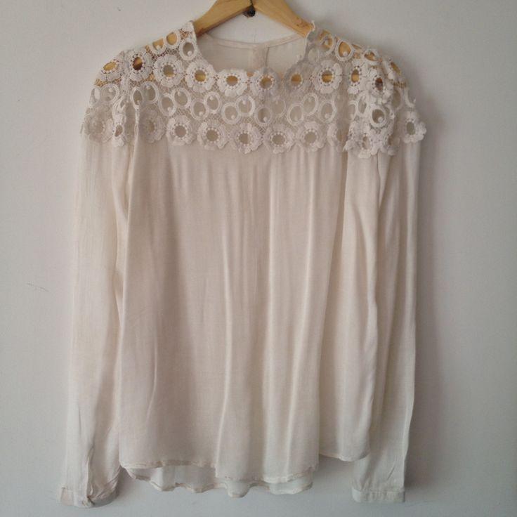 An basic handmade white blouse, made in home.