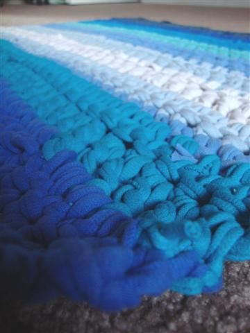 Tee shirt yarn bath mat - CROCHET use  one of those big turquoise hooks about the size of a finger (don't you love precise measurements?) and the rug was done in all double crochet except one row of single crochet in the second row of light blue (because I was running out of yarn).
