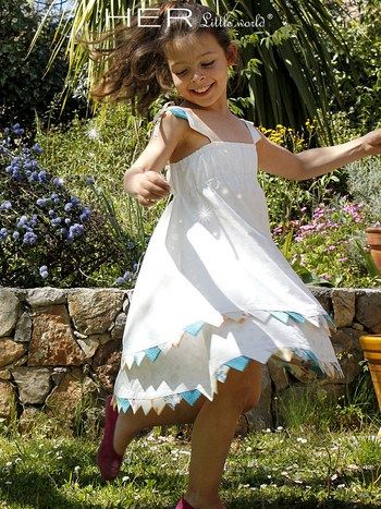 HER Little World - Free pattern & tutorial, ages 2-10.  This is a lined dress with a bunting edge.  Pattern is European style with no seam allowances.