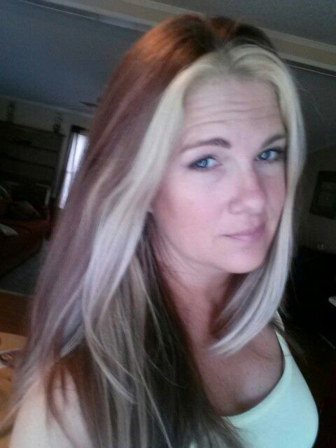 Auburn with heavy blonde highlights around the face